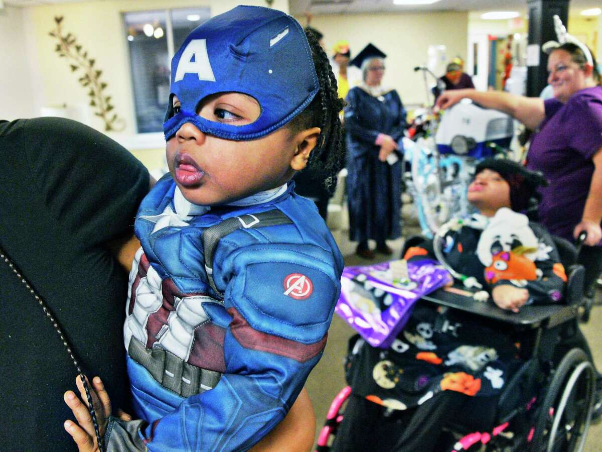 Three-year-old Christian James has a lot to take in during the 7th annual Halloween parade for pediatric unit patients at Pathways Nursing and Rehabilitation Wednesday Oct. 31, 2018 in Niskayuna, NY. (John Carl D'Annibale/Times Union)
