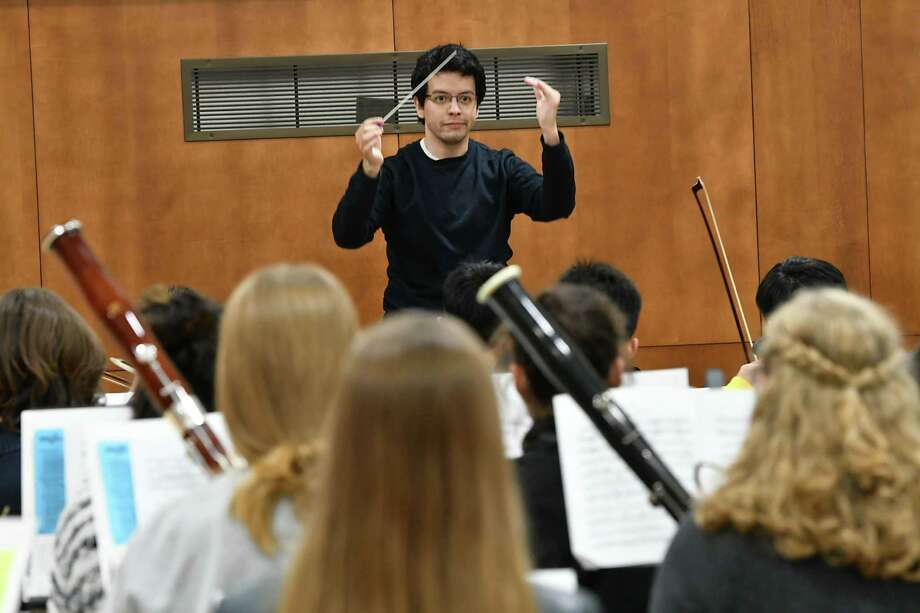 Carlos cgreda, the new conductor of the Empire State Youth Orchestra, leads a rehearsal at The Brown School ahead of ESYO's fall opener on Nov. 3 on Tuesday, Oct. 23, 2018 in Schenectady, N.Y. (Lori Van Buren/Times Union) Photo: Lori Van Buren / 20045146A
