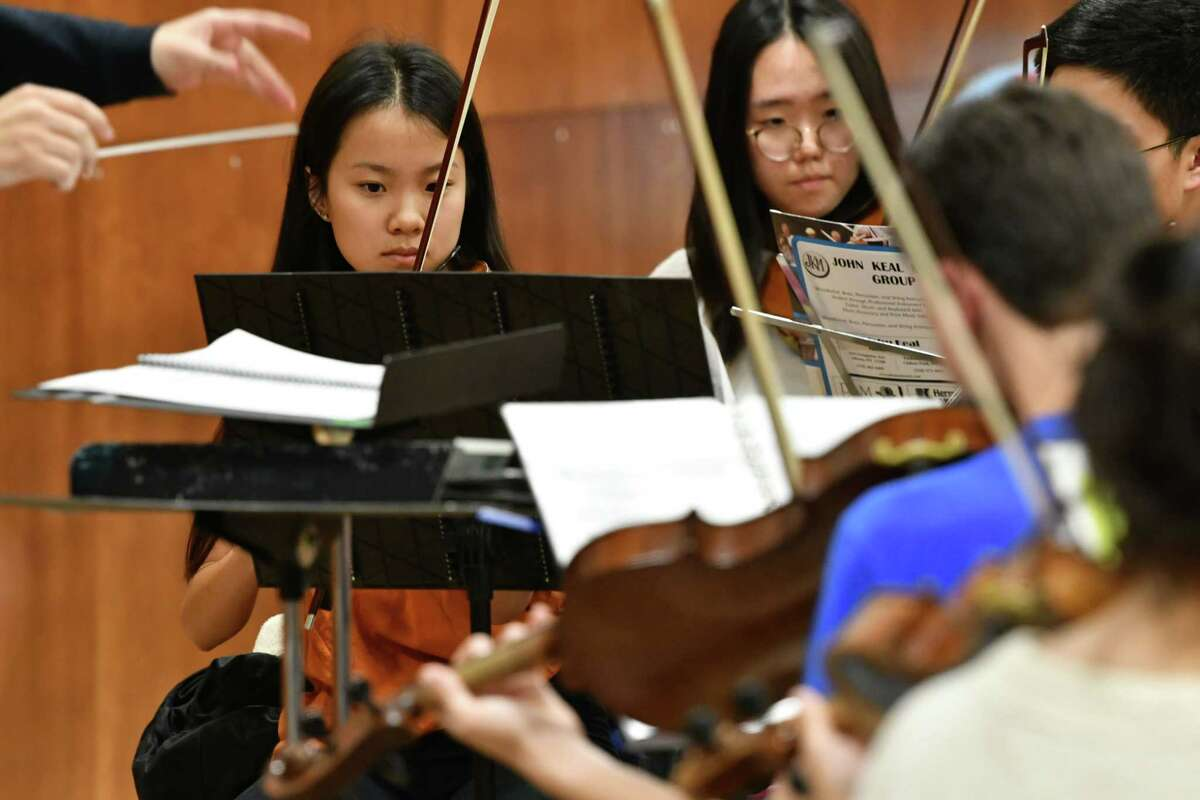 Concertmaster Lydia Liang of Niskayuna, left, plays her violin as the Empire State Youth Orchestra rehearses at The Brown School ahead of ESYO's fall opener on Nov. 3 on Tuesday, Oct. 23, 2018 in Schenectady, N.Y. (Lori Van Buren/Times Union)