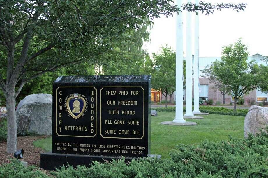 Flag poles in front of Darien town hall. Photo: Humberto J. Rocha /Hearst Connecticut Media / Darien News