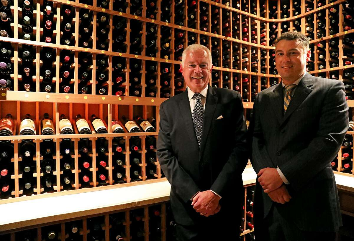 Giancarlo Paterlini, left, and his son, Gianpaolo Paterlini, pose for a portrait inside a wine cellar at Acquerello in San Francisco, Calif., on Tuesday, October 30, 2018. The restaurant is located at 1722 Sacramento St.