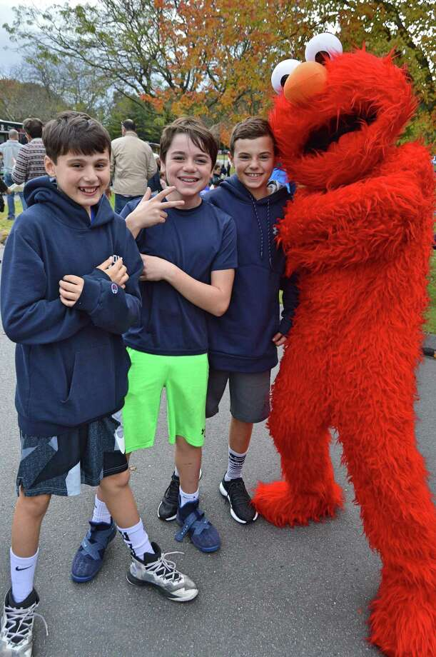 Ryan Luchetta, Cole Galante and Luke Ginsburg from Wilton pose with Elmo at the Food Truck Festival held at the Miller/Driscoll school complex in Wilton, Conn. on Sunday, October 28, 2018. Photo: Nicole Zappone / For Hearst Connecticut Media / Connecticut Post Freelance