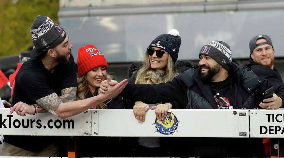 Boston Red Sox's Blake Swihart, left, shakes hands with Sandy Leon during a parade to celebrate the team's World Series championship over the Los Angeles Dodgers, Wednesday, Oct. 31, 2018, in Boston. Photo: Elise Amendola, AP / Copyright 2018 The Associated Press. All rights reserved.