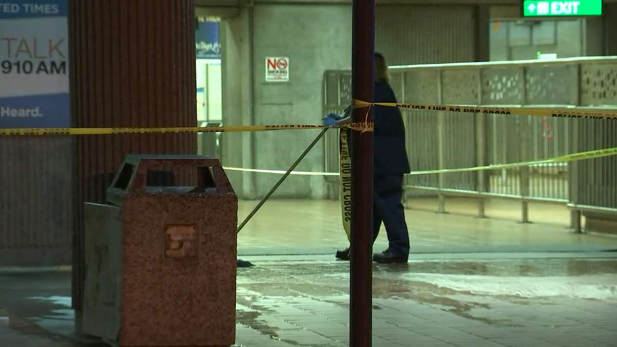 BART employees clean up the Ashby BART station after a bleeding man walked in and left a pool of blood.