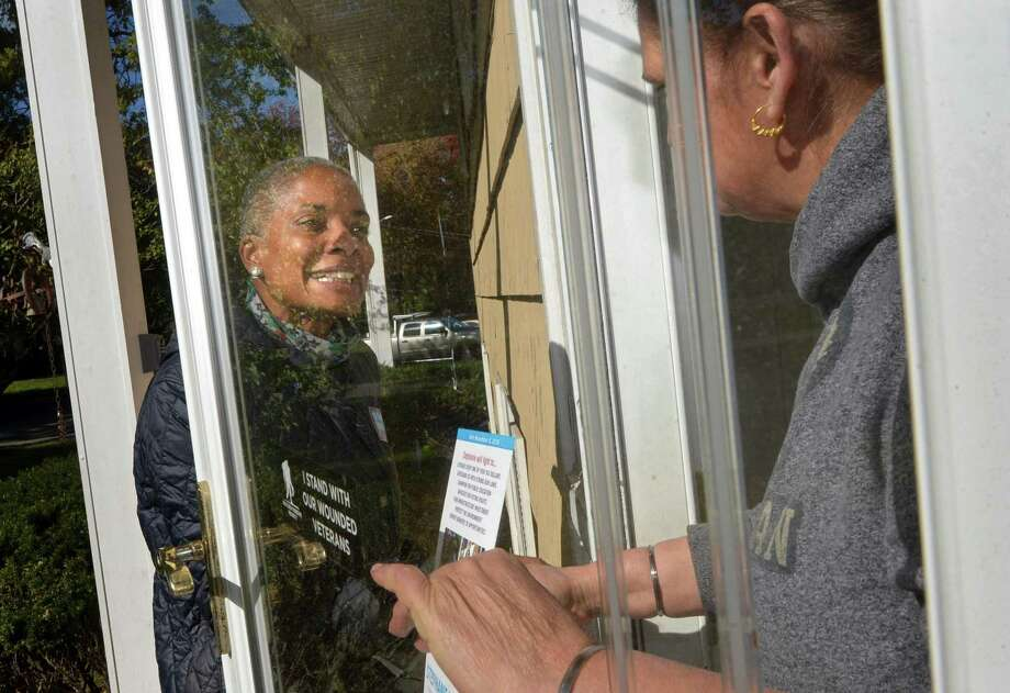 Democratic candidate for the State Representative District 143th seat, Stephanie Thomas, canvasses Thursday, October 25, 2018, on Holiday Dr. in Norwalk, Conn. Photo: Erik Trautmann / Hearst Connecticut Media / Norwalk Hour