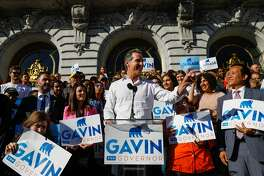 Gavin Newsom speaks to his supporters outside City Hall in San Francisco, California, on Tuesday, Oct. 30, 2018. In the last days of his race for governor, Newsom has yet to promise to divest from his many business holdings.
