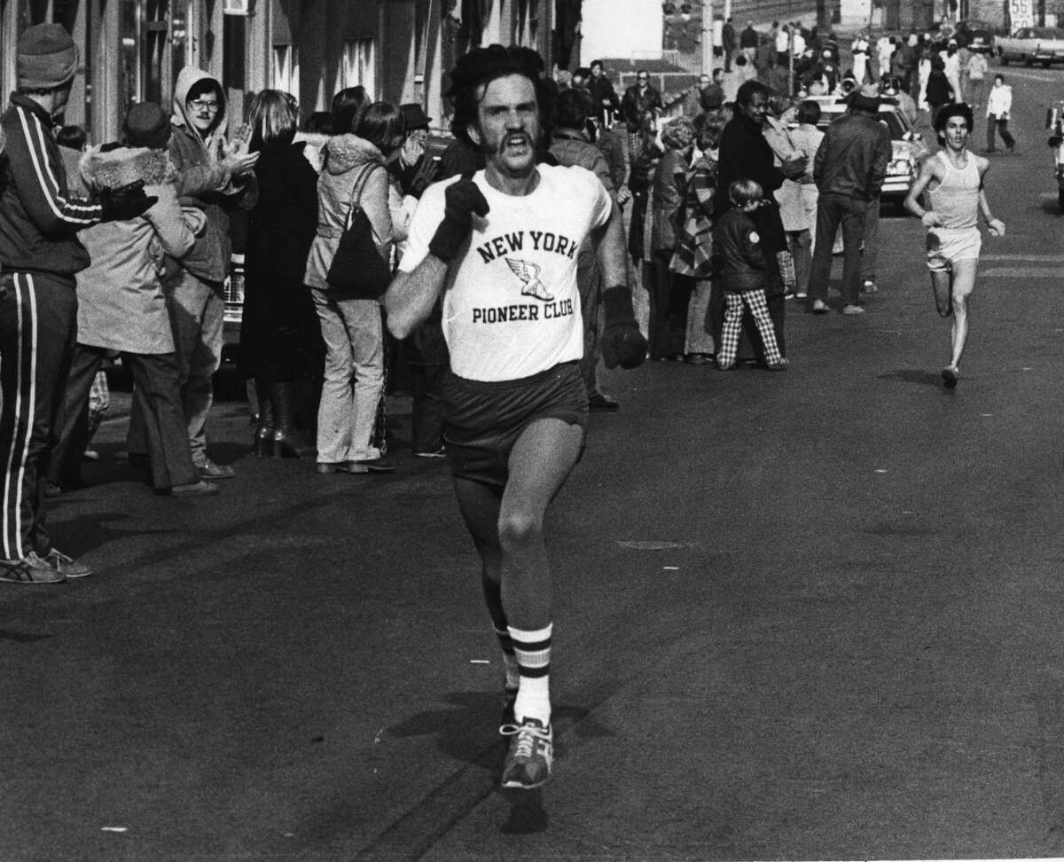 Troy Turkey Trot, men's division winners: Steve Jones of the Pioneer Club from Saratoga Springs goes to Skidmore College. Bill Martin Troy, N.Y. goes to Brockport College. 11/26/1976. (Times Union archive) .