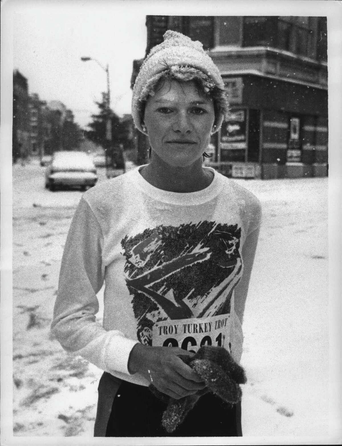 Ellen Weglarz Predmore wins the 10k for the fourth time  in rough weather in 1985. She has eight wins in the 10k and two wins in the 5k. (Paul D. Kniskern Sr./Times Union Archive)