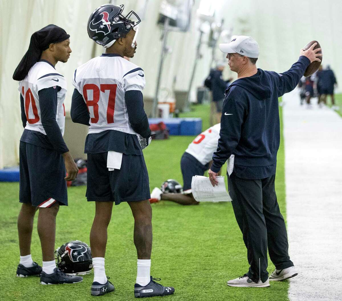 Houston Texans wide receivers DeAndre Hopkins (10), and Demaryius Thomas (87) listen to wide receivers coach John Perry during practice at The Methodist Training Center on Wednesday, Oct. 31, 2018, in Houston. Thomas was aquired by the Texans in an NFL trade deadline deal with the Denver Broncos.