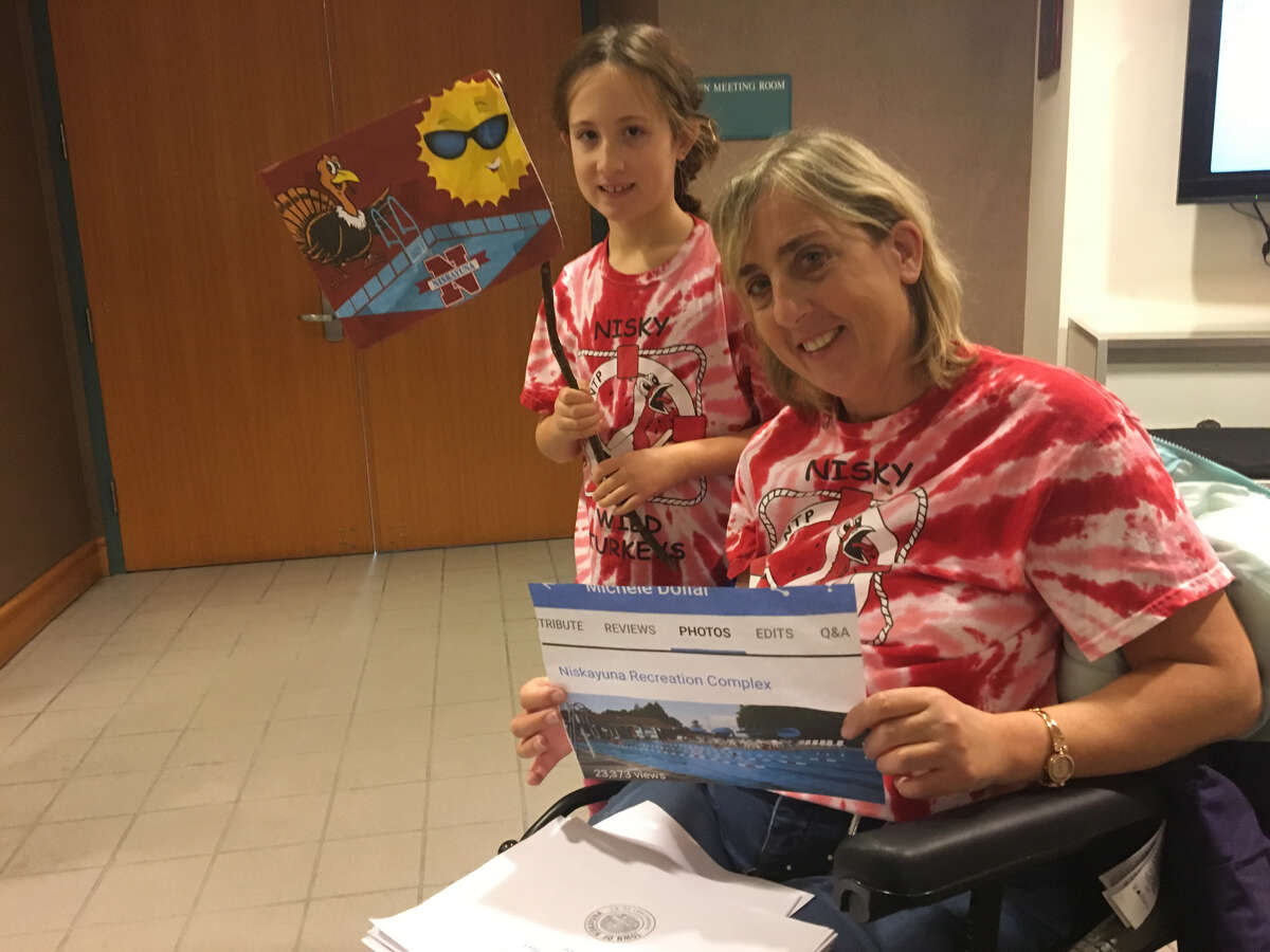 Michele Dollar and her 9-year-old, Brieanna, attended the Niskayuna budget hearing to protest a proposed increase in pool rates, which has been removed from next year's budget, on Tuesday, Oct. 30, 2018 at Town Hall.