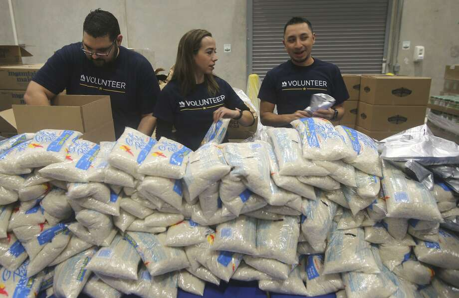Volunteers from USAA pack boxes of food for seniors Friday November 3, 2017 at the San Antonio Food Bank. Food banks across the country say they welcome the upcoming influx of food the USDA is buying to make up for export markets lost to trade war tariffs but aren't prepared logistically to handle it. Photo: John Davenport /San Antonio Express-News / ©John Davenport/San Antonio Express-News