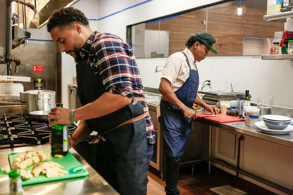 Co-owner Matthew Washington cuts plantains as he and owner Jay Foster try out recipes for their new restaurant Isla Vida on Fillmore Street in San Francisco, on Friday, August 31, 2018 in San Francisco, Calif.
