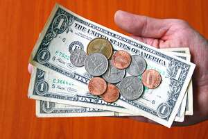 Giving Money: USA Dollar Bank Notes and CoinsBank Notes Money Paper Coins USA US Dollar Euro Doller cent cents 100 1 hand giving give hand over transfer cost pay payment paying expense expenses paying
