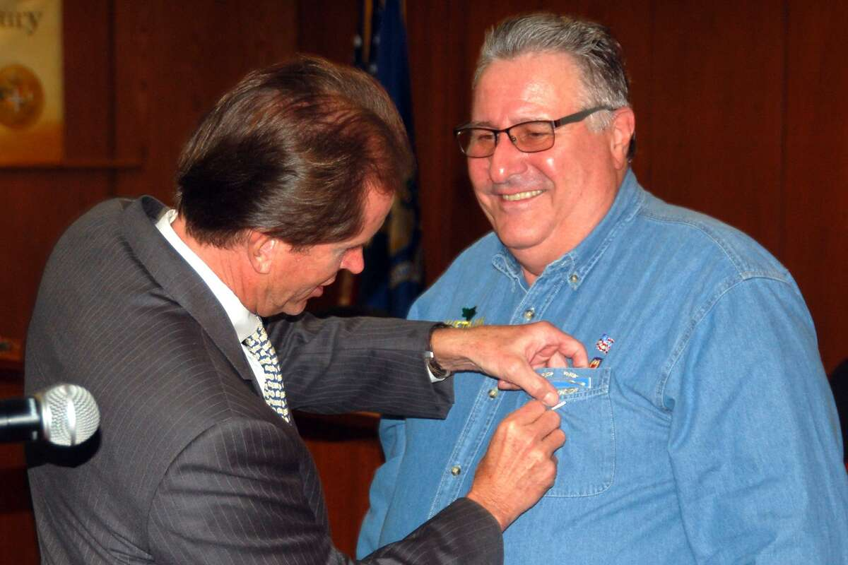 State Sen. L. Scott Frantz pins a Connecticut Wartime Medal on the chest of Joe Musich, a Vietnam veteran. The medals were given out at a special ceremony at Town Hall where seven local veterans were honored for their service.