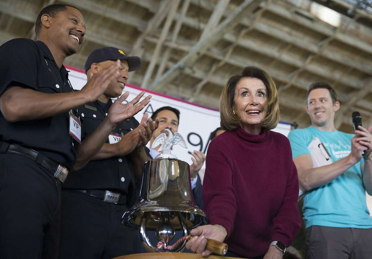 House Minority Leader Nancy Pelosi rings the bell to officially kick off a meal packing event held by the 9/11 Day organization honoring the national Day of Service at Pier 35 in San Francisco, Calif. Tuesday, Sept. 11, 2018.