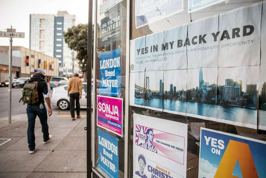 Campaign posters are seen in the windows of the YIMBY Action headquarters. Photo: Jessica Christian / The Chronicle