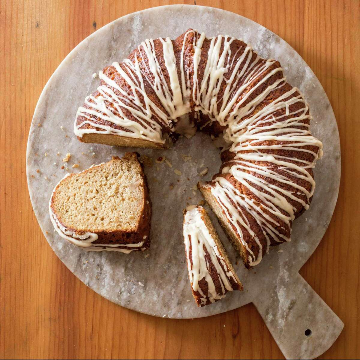"""This undated photo provided by America's Test Kitchen in October 2018 shows a cider-glazed apple bundt cake in Brookline, Mass. This recipe appears in the cookbook """"All-Time Best Brunch."""" (Carl Tremblay/America's Test Kitchen via AP)"""