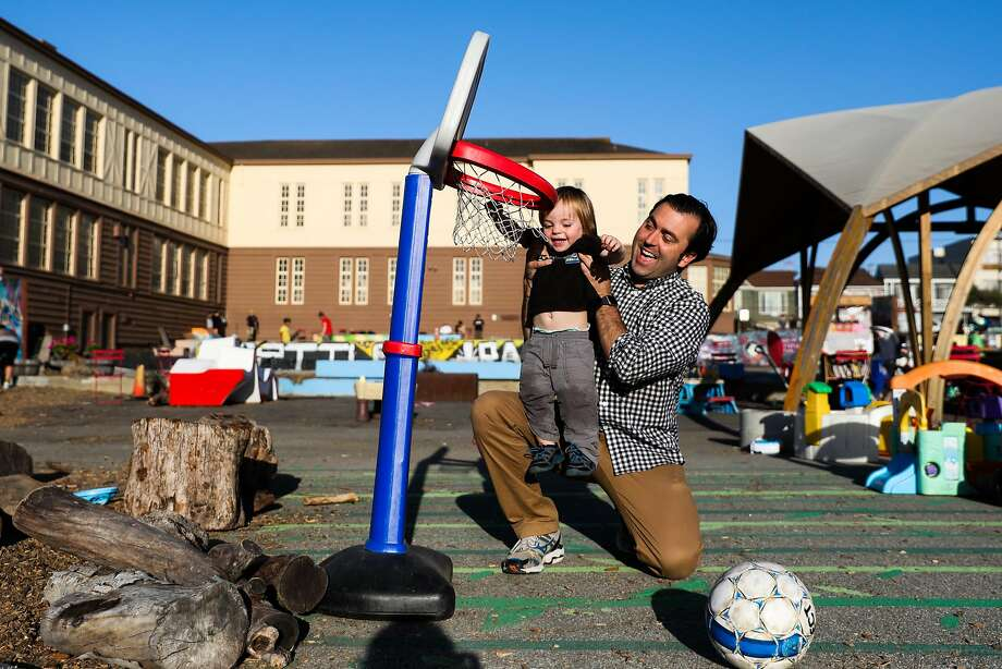 District Four candidate Trevor McNeil helps his son Nicasio, 1, reach the basket at Playland on 43rd Avenue in San Francisco. Photo: Gabrielle Lurie / The Chronicle