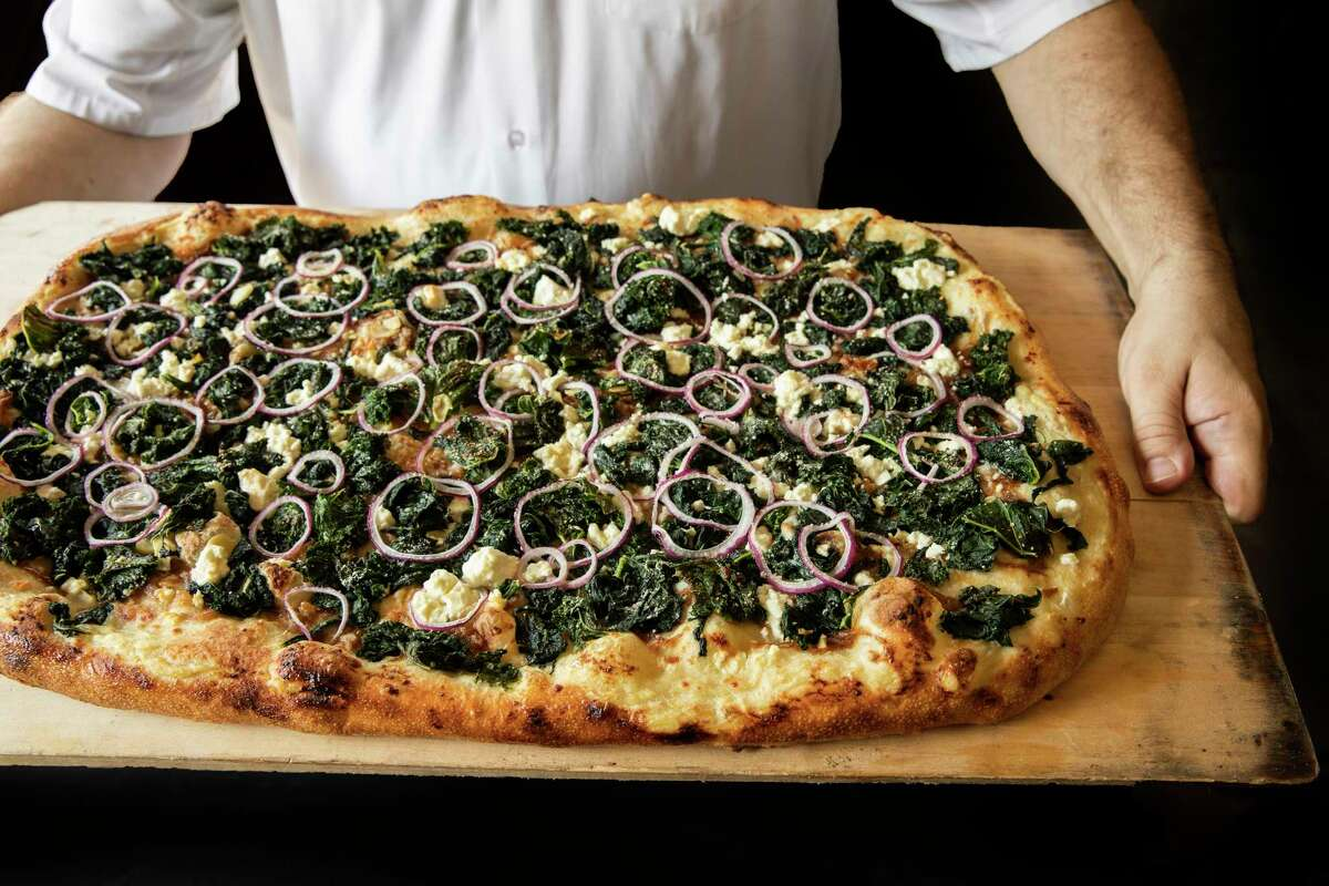 Curly kale, red onion, caramelized onion and feta pizza from Vinny's a new pizza restaurant open at 1201 St. Emanuel from Agricole Hospitality (Revival Market, Coltivare, Eight Row Flint).