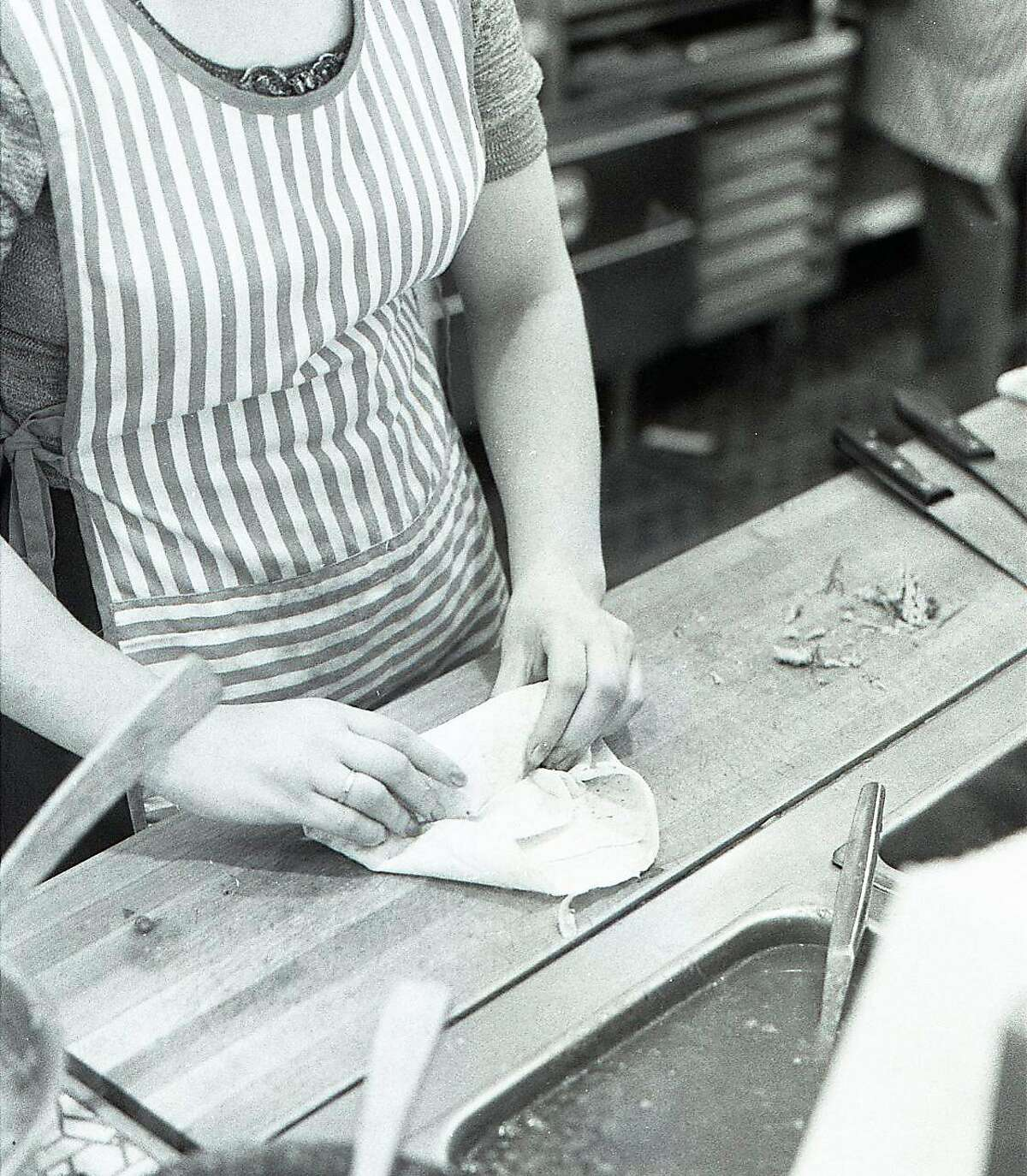 Jan. 20, 1977: A restaurant worker at Nito Burrito assembles a burrito at the San Francisco restaurant.
