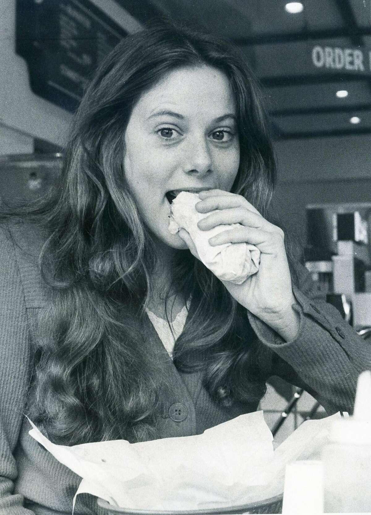 Jan. 20, 1977: Lynn Moreno, 22, eats a burrito at Nito Burrito in S.F.