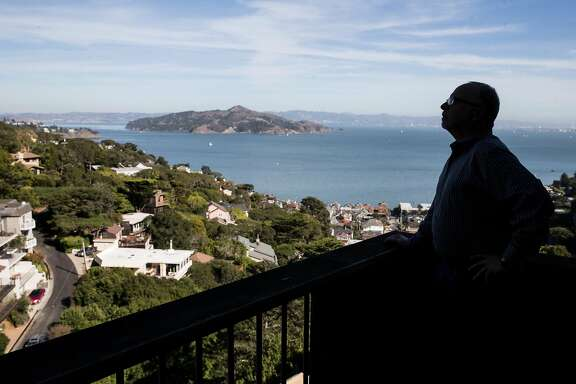 Sausalito homeowner David Holub looks out from the balcony of his home in Sausalito, Calif. Friday, Oct. 26, 2018. Members of the YIMBY party assisted Holub in getting plans approved for a second structure on his hillside property.