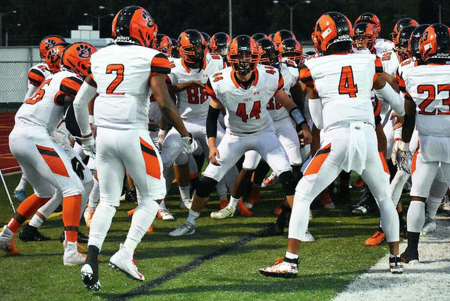 The Edwardsville football team pumps itself up before the start of a regular season game at O'Fallon. Photo: Matt Kamp/Intelligencer