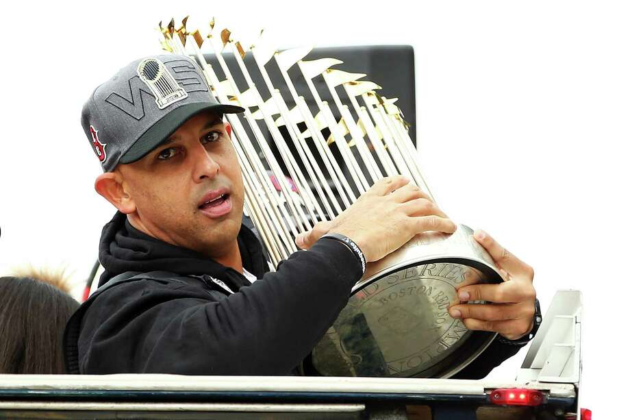 BOSTON, MA - OCTOBER 31:  Boston Red Sox Manager Alex Cora holds the World Series trophy during the 2018 World Series victory parade on October 31, 2018 in Boston, Massachusetts. Photo: Adam Glanzman, Getty Images / 2018 Getty Images
