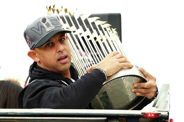 BOSTON, MA - OCTOBER 31: Boston Red Sox Manager Alex Cora holds the World Series trophy during the 2018 World Series victory parade on October 31, 2018 in Boston, Massachusetts.