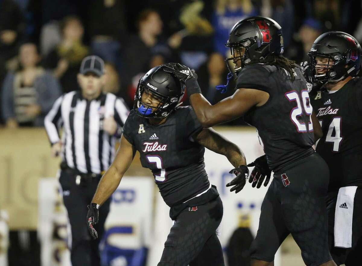 Tulsa running back Shamari Brooks (3) celebrates with teammate Justin Hobbs (29) during a game against South Florida on Oct. 12.