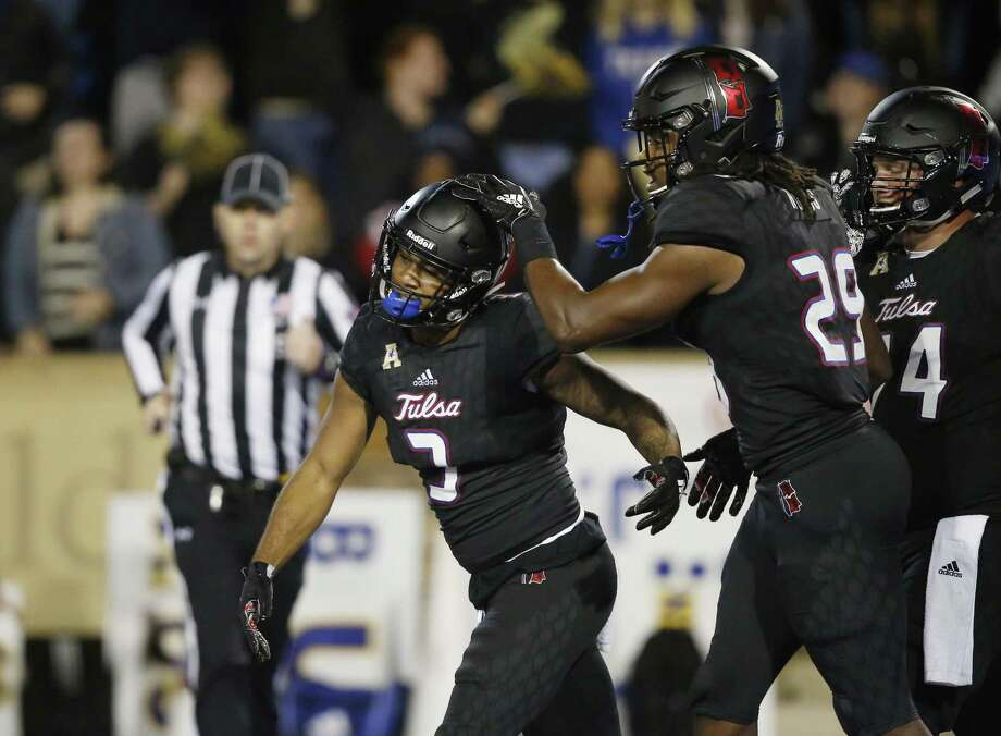 Tulsa running back Shamari Brooks (3) celebrates with teammate Justin Hobbs (29) during a game against South Florida on Oct. 12. Photo: Sue Ogrocki / Associated Press / Copyright 2018 The Associated Press. All rights reserved.
