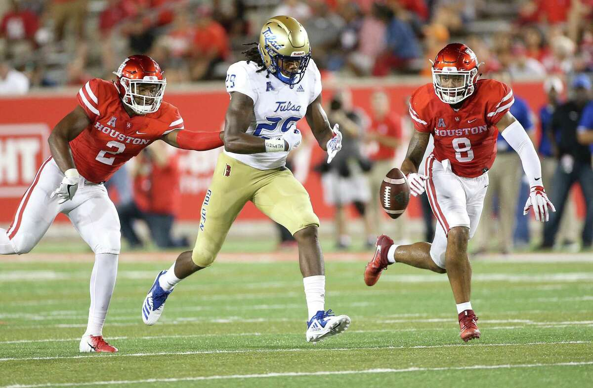 Houston defensive back Deontay Anderson (2) causes a turnover against Tulsa wide receiver Justin Hobbs (29) on Oct. 4.
