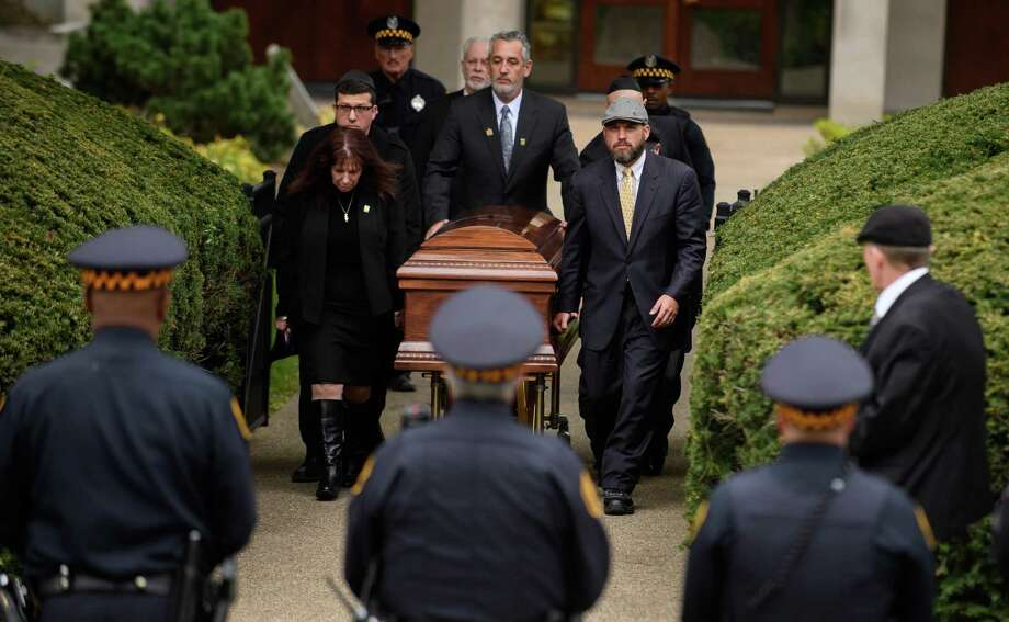 PITTSBURGH, PA - OCTOBER 31: The casket of Irving Younger is led to a hearse outside Rodef Shalom Temple following his funeral on October 31, 2018 in Pittsburgh, Pennsylvania. Irving Younger was one of 11 people killed in the mass shooting at the Tree of Life Synagogue on October 27. (Photo by Jeff Swensen/Getty Images) Photo: Jeff Swensen / Getty Images / 2018 Getty Images