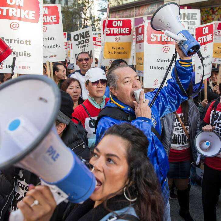 Hotel and hospitality workers on strike from seven different Marriott-affiliated hotels gather at Yerba Buena Lane and Market Street Saturday, Oct. 20, 2018 in San Francisco, Calif. before taking to the streets in a massive march.
