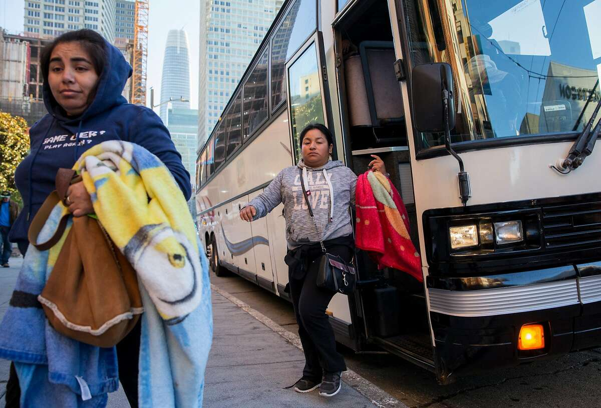 Marriott workers from Salinas, Calif. who wished not to be identified are dropped off by a shuttle bus to work at the Marriott Marquis in San Francisco, Calif. Tuesday, Oct. 30, 2018 as daily Marquis workers continue to strike.
