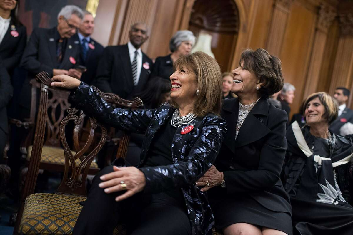 UNITED STATES - JANUARY 30: Rep. Jackie Speier, D-Calif., left, is positioned for a picture by Rep. Anna Eshoo, D-Calif., during a photo op in the Capitol's Rayburn Room to show solidarity with men and women who are speaking out against sexual harassment and discrimination on January 30, 2018. (Photo By Tom Williams/CQ Roll Call)
