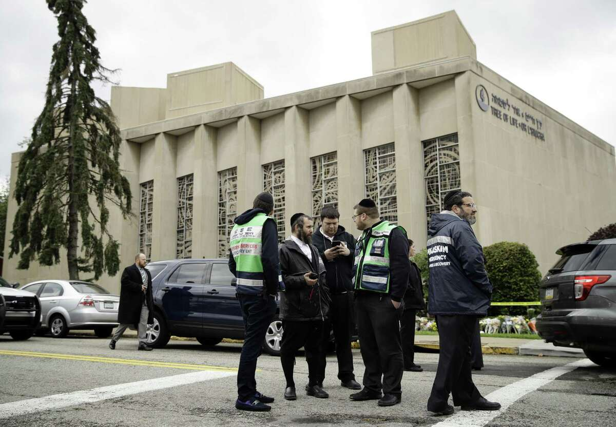 Personnel from Chesed Shel Emes Emergency Services and Recovery Unit gather near the Tree of Life Synagogue in Pittsburgh, Sunday. Readers discuss the tragedy.