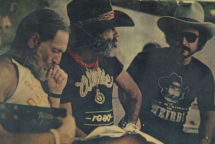 Willie Nelson, left, was among the many well-known Texas musicians that Sam Kindrick, center, hung out with and also wrote about in Action Magazine decades ago. Also pictured is Joe Cardenas, an old friend of Kindrick.