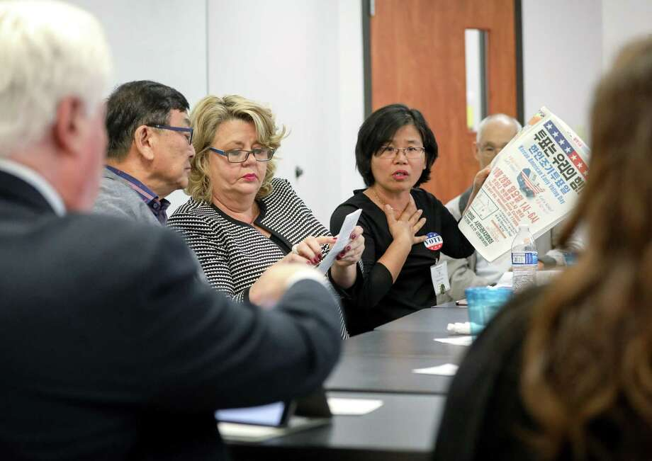 Hyunja Norman, center, talks about voting information available to Korean-Americans during a meeting with the Harris County Clerk's Office at the Korean Community Center, Wednesday, Oct. 31, 2018, in Houston. The county clerk's office met with Korean-American voters after several translators had been barred from the Trini Mendenhall Community Center voting location on Sunday. Photo: Jon Shapley, Staff Photographer / Staff Photographer / © 2018 Houston Chronicle