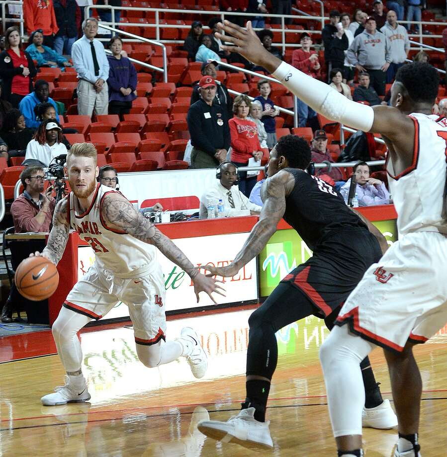 Lamar's Colton Weisbrod drives past Nicholls' Jahvaughn Powell during their match-up Wednesday at the Montagne Center.  Photo taken Wednesday, January 24, 2018 Kim Brent/The Enterprise Photo: Kim Brent / Beaumont Enterprise / BEN
