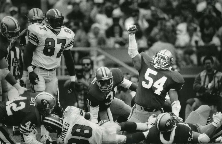 In this file photo, former Raider Matt Millen, now playing for the 49ers signals victory  as the dense stuffs the Falcons drive, November 12, 1989. Photo: Brant Ward / The Chronicle 1989