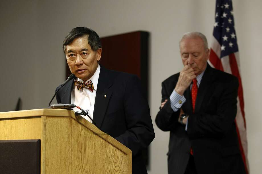 Maryland President Wallace Loh announces DJ Durkin would remain football coach Tuesday as Board of Regents head James Brady observes. Photo: Patrick Semansky / Associated Press
