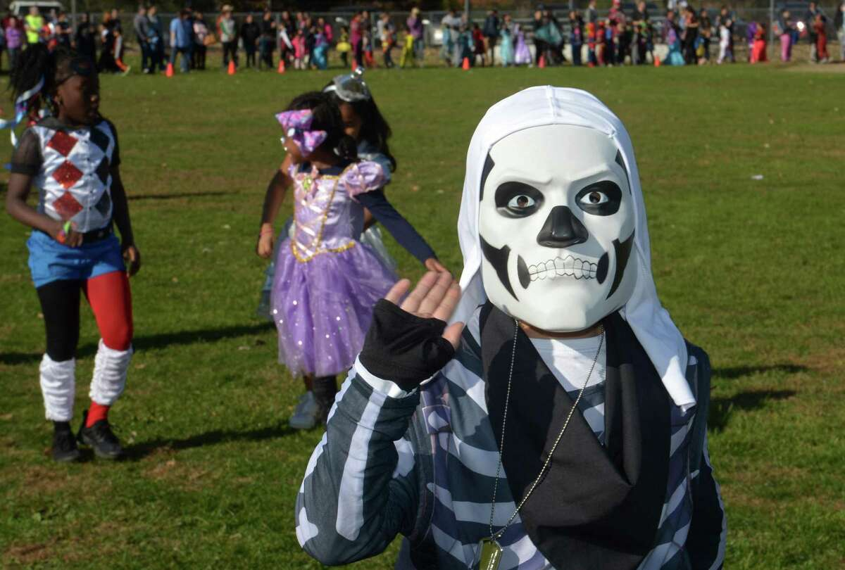 Second grader Jacob Palacios marches with his class during the Brookside Elementary School annual schoolwide Halloween Parade Wednesday, October 31, 2018, at the school in Norwalk, Conn.