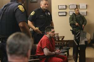 Heavy armed security detail surround Daniel Moreno Lopez during a break in his sentencing hearing in the Bexar County 379th Criminal District Court, Wednesday, Oct. 31, 2018. Lopez was convicted in the murder and dismemberment of Jose Luis Menchaca in September of 2014.