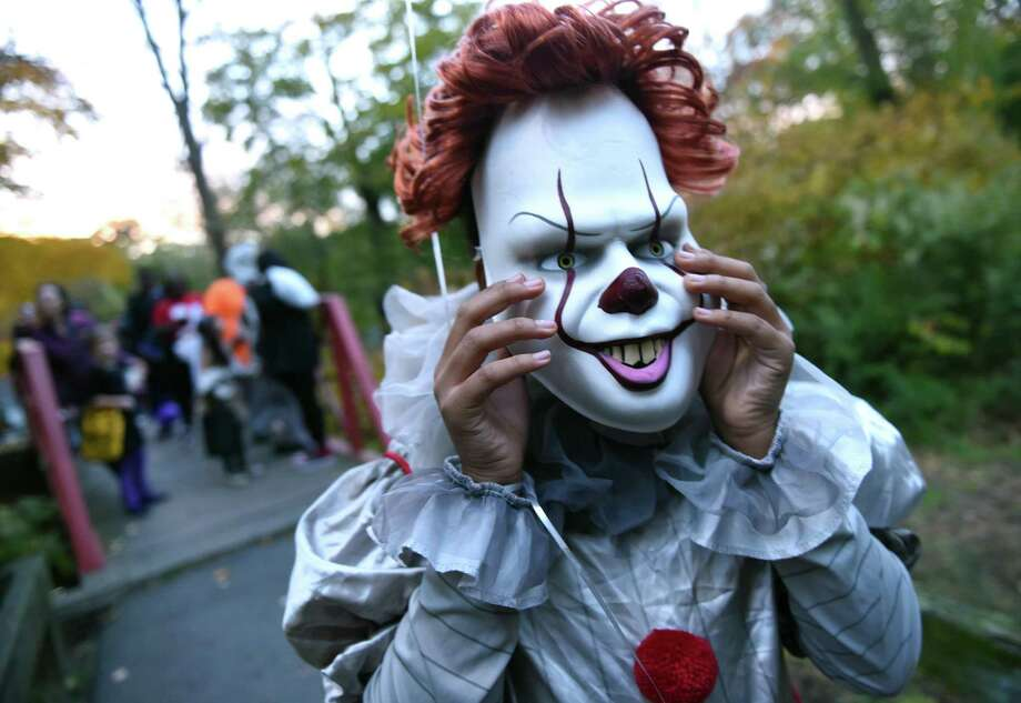Niyel Cornelius, 12, of New Haven dressed as the clown, It, adjusts her mask before the start of the Trunk or Treat event at Edgewood Park in New Haven on October 31, 2018. Photo: Arnold Gold / Hearst Connecticut Media / New Haven Register