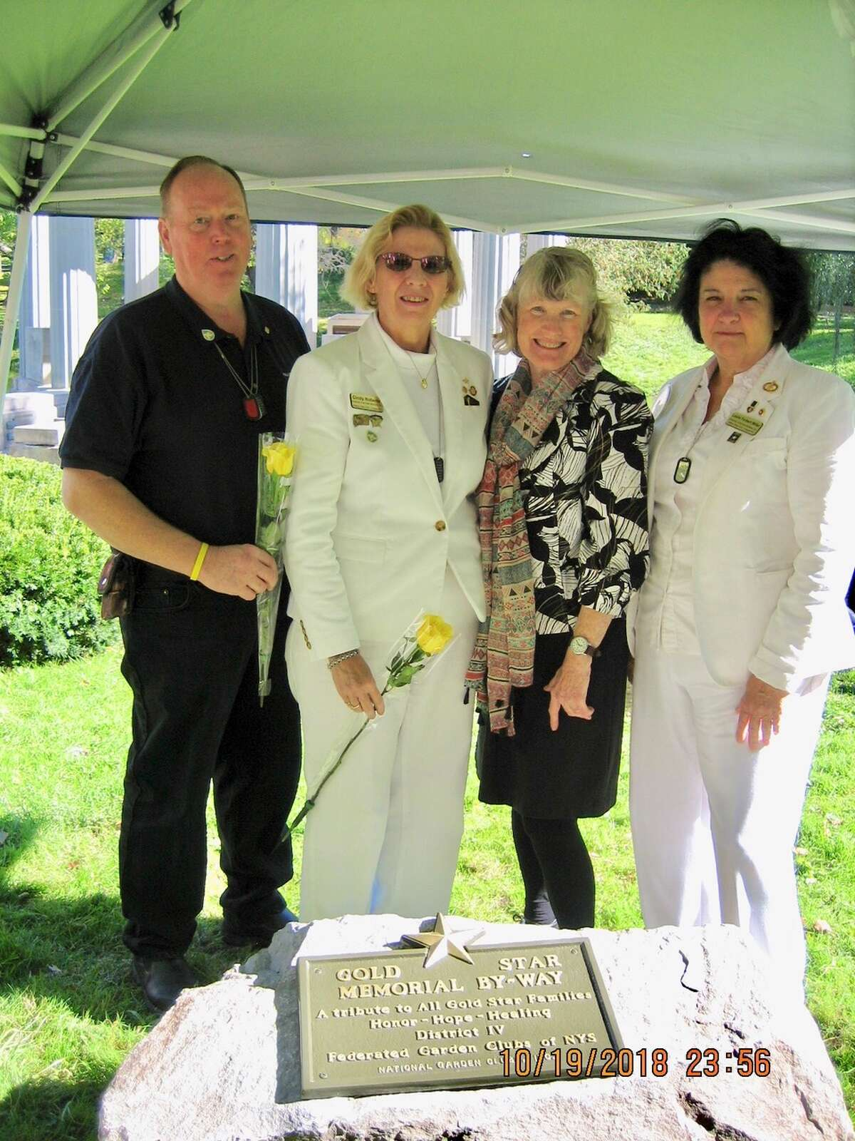Bob and Cindy Roberts (Gold Star parents), Charlanne Ryan-Donough, Assistant Director of District IV Garden Clubs, and Leslie Forbet Miller ( Gold Star mother) attend an Oct. 20 Gold Star Mother's event in Saratoga Springs. (Provided photo)