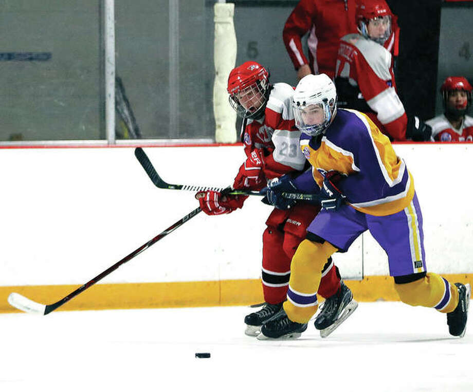 Civic Memorial's Nolan Kahl, right, and Alton's Zach Carter battle for a loose puck during a game last season at the East Alton ice Arena. The 2018-19 MVCHA season will get under way Monday. Photo: Billy Hurst File Photo | For The Telegraph