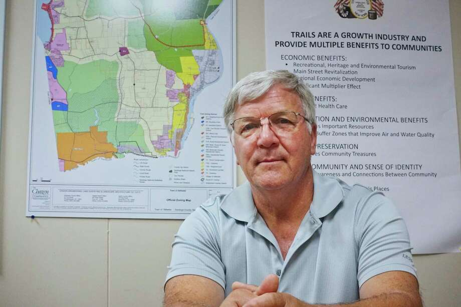 Ed Kinowski, Stillwater town supervisor and chair of Saratoga County Board of Supervisors, poses at Stillwater Town Hall with a Town of Stillwater Official Zoning Map on Tuesday, Sept. 4, 2018, in Stillwater, N.Y.  (Paul Buckowski/Times Union) Photo: Paul Buckowski / (Paul Buckowski/Times Union)
