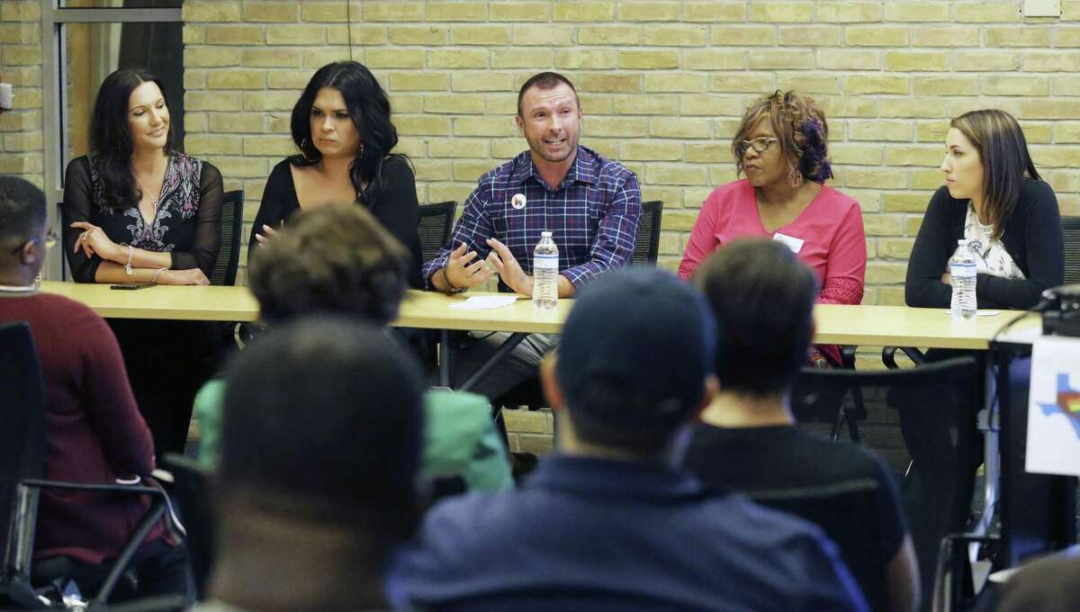 A panel answers questions during a town hall Oct. 30, 2018, at the Carver Library about a study of resiliency in the LGBTQ community in San Antonio. From left are Jamie Zapata, Luka Rios, Greg Casillas, the Rev. Naomi Brown and Kimberly Berry.