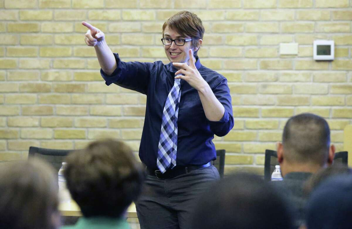 Trinity University associate professor Amy Stone presents the results of a survey of the LGBTQ community at a meeting at the Carver Library on Oct. 30, 2018.